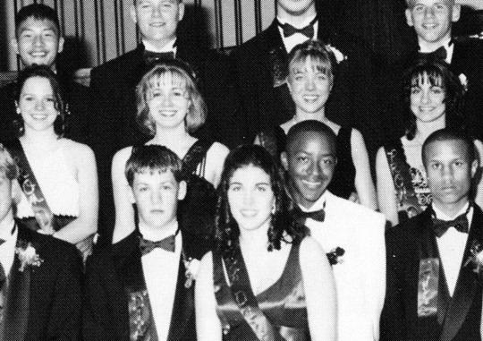 <p>Joel Madden, front left, wasn't always a tattooed rocker. This 1997 photo from his prom at La Plata High School in La Plata, Md., shows him wearing a suit while being honored as a member of his school's prom court. Still, don't be fooled, because he and twin brother, Benji, had already formed their famous band, Good Charlotte. (Photo: Seth Poppel/Yearbook Library) </p>