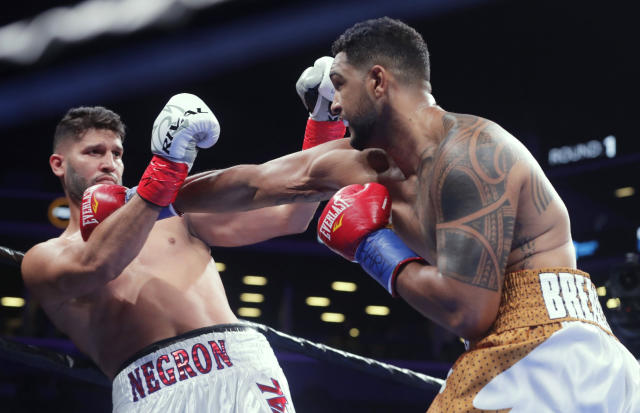FILE - In this Dec. 22, 2018, file photo, Dominic Breazeale, right, punches Carlos Negron during the first round of a heavyweight boxing match in New York. Breazeale stopped Negron in the ninth round. Breazeale faces Deontay Wilder on Saturday, May 18. (AP Photo/Frank Franklin II, File)