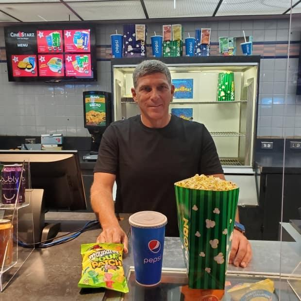 Bruce Gurberg, owner and president of Ciné Starz in Montreal, says he's willing to bet on business eventually picking back up at his movie theatres. (Kwabena Oduro/CBC - image credit)