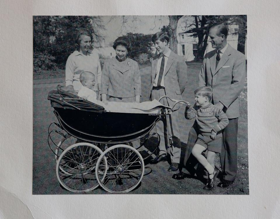 A photograph from a Christmas card dated 1965 showing Queen Elizabeth II and the Duke of Edinburgh alongside their children Princess Anne and Prince Edward (left), Prince Charles (centre) and Prince Andrew (right), at Omega Auctions in Stockport. [Photo: PA]