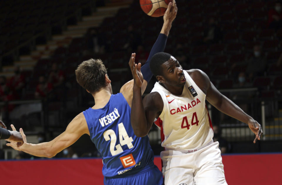 Canada's Andrew Nicholson, right, and Czech Republic's Jan Vesely juggle the ball during the first half of a FIBA men's Olympic basketball qualifying semifinal at Memorial Arena in Victoria, British Columbia, Saturday, July 3, 2021. (Chad Hipolito/The Canadian Press via AP)