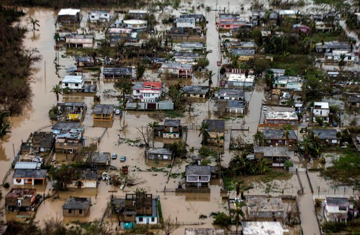 Loiza, PUERTO RICO SEPTEMBER 22: Aerial photo of the floadings in the costal town of Loiza, in the north shore of Puerto RicoHurricane Maria passed through Puerto Rico leaving behind a path of destruction across the national territory. (Photo by Dennis M. Rivera Pichardo for The Washington Post via Getty Images)
