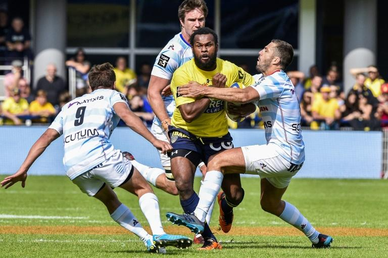 Clermont's Fijian winger Alivereti Raka (C) is tackled during the French Top 14 Rugby Union match ASM Clermont vs Racing 92 at the Michelin stadium in Clermont-Ferrand, central France, on September 23, 2017
