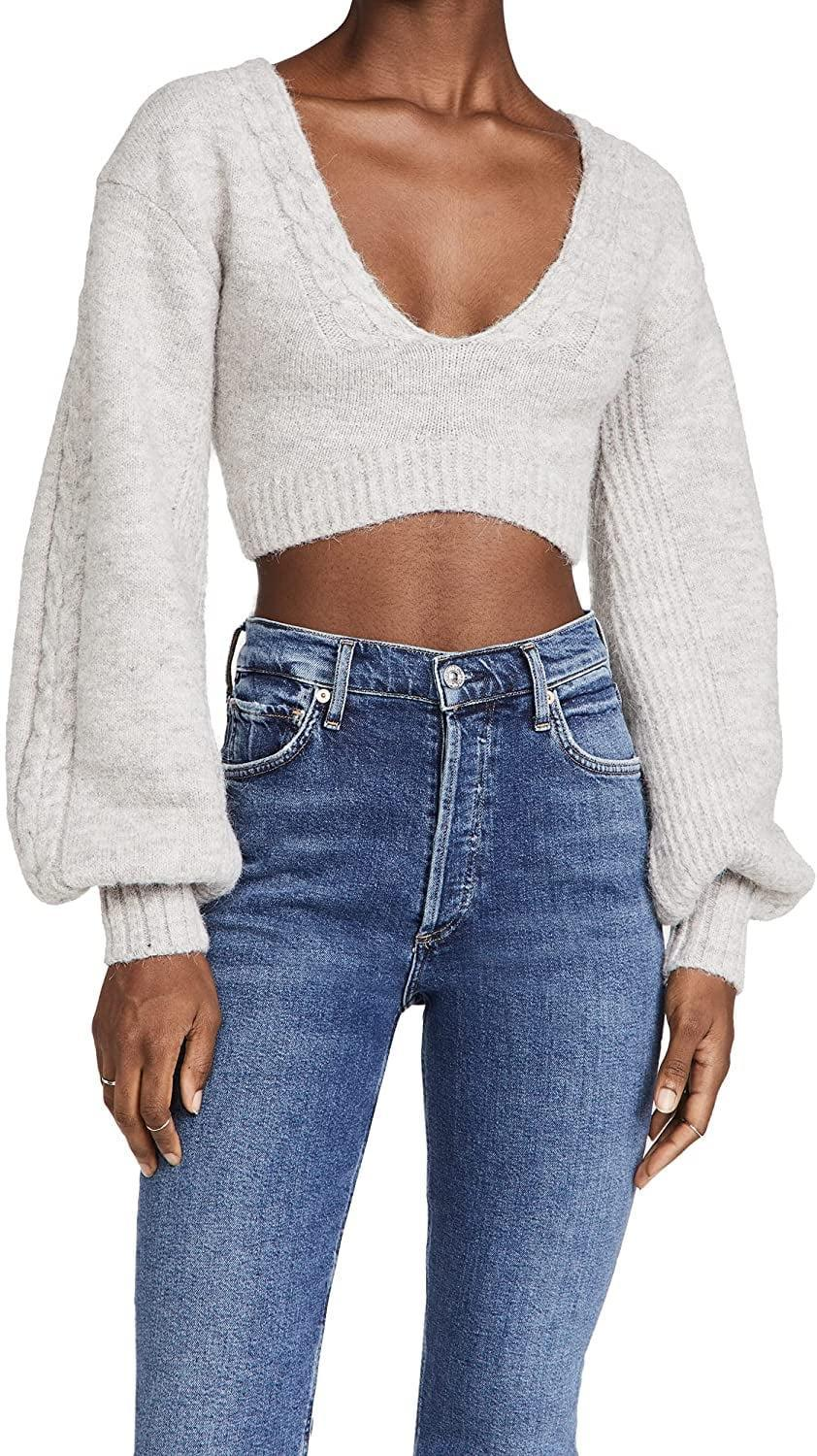 <p>The sleeves may be oversized, but this <span>For Love and Lemons Amelia Crop Sweater</span> ($154) has a slim chance of not making a statement on a night out. The cropped shape is a great contrast to the cool, large sleeves.</p>