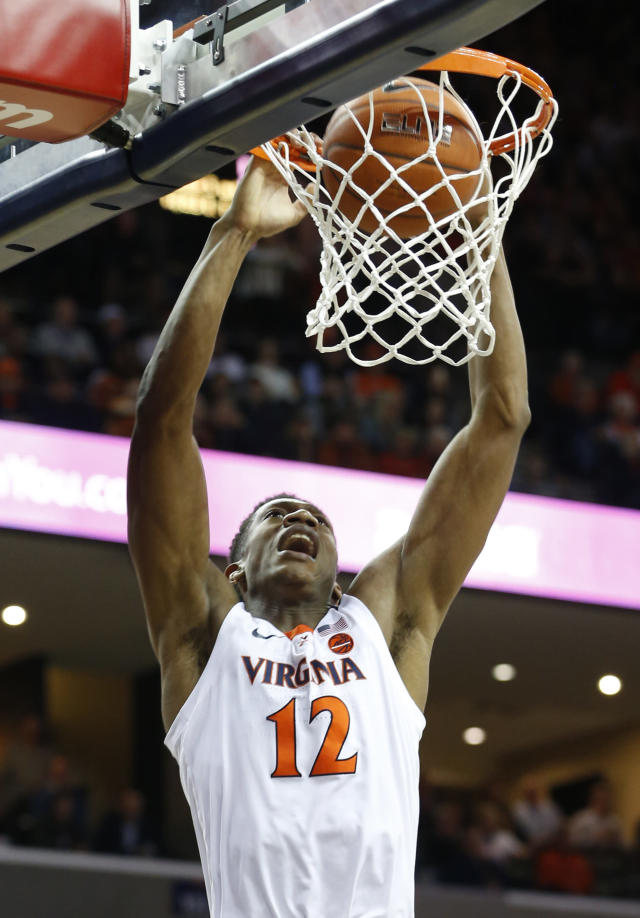 Virginia guard De'Andre Hunter (12) slams home a dunk during the first half of an NCAA college basketball game against Virginia Tech, in Charlottesville, Va., Tuesday, Jan. 15, 2019. (AP Photo/Steve Helber)