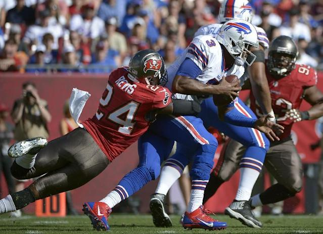 FILE - In this Dec. 8, 2013 file photo, Buffalo Bills quarterback EJ Manuel (3) is sacked by Tampa Bay Buccaneers cornerback Darrelle Revis (24) during the second quarter of an NFL football game in Tampa, Fla. As Day 2 of the NFL's free-agency period began to unfold, Carolina Panthers receiver Steve Smith and Tampa Bay Buccaneers cornerback Darrelle Revis were waiting to find out whether they might be traded or released. (AP Photo/Phelan M. Ebenhack, File)