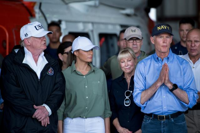<p>President Donald Trump (L), First Lady Melania Trump (2nd L) listen to Florida Governor Rick Scott as he speaks during a briefing on Hurricane Irma relief efforts at Southwest Florida International Airport in Fort Myers, Sept. 14, 2017, in Fort Myers, Fla. (Photo: Brendan Smialowski/AFP/Getty Images) </p>