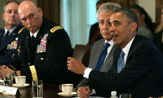 President Obama meets with military leaders, including Defense Secretary Chuck Hagel, on May 16.