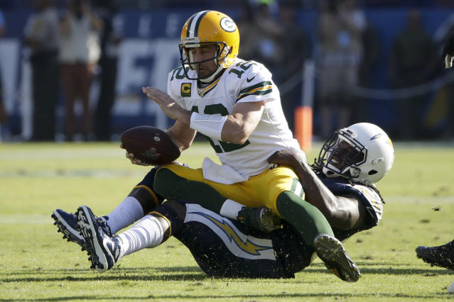 Green Bay Packers quarterback Aaron Rodgers is sacked by Los Angeles Chargers defensive end Melvin Ingram during the first half of an NFL football game Sunday, Nov. 3, 2019, in Carson, Calif. (AP Photo/Marcio Jose Sanchez)