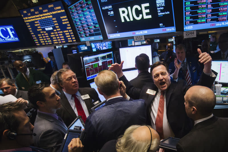 FILE PHOTO - Traders yell as they wait for the IPO of gas drilling company Rice Energy Inc. on the floor of the New York Stock Exchange in the Manhattan borough of New York