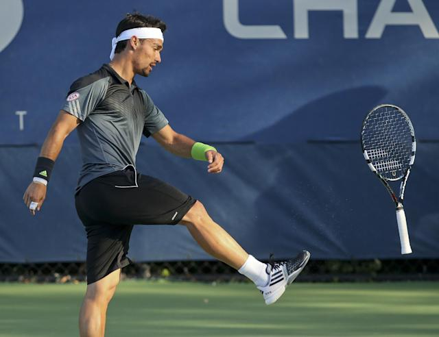 Fabio Fognini, of Italy, kicks his racket after a point against Adrian Mannarino, of France, during the second round of the 2014 U.S. Open tennis tournament, Friday, Aug. 29, 2014, in New York. (AP Photo/John Minchillo)
