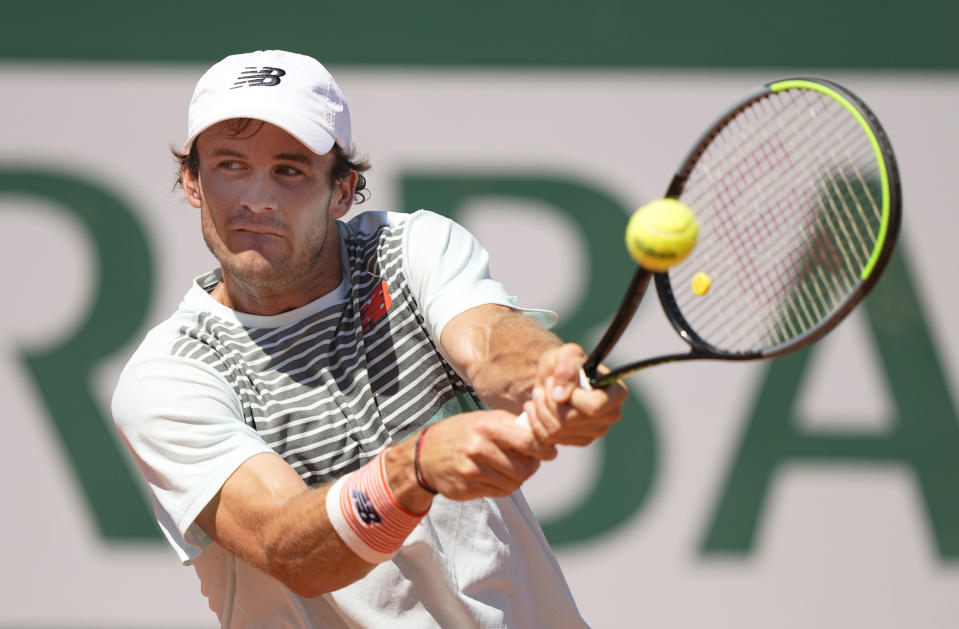 United States's Tommy Paul plays a return to Australia's Christopher O'Connell during their first round match on day two of the French Open tennis tournament at Roland Garros in Paris, France, Monday, May 31, 2021. (AP Photo/Michel Euler )