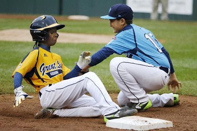 Chicago's Jaheim Benton, left, slides safely into third ahead of the tag by Las Vegas' Dillon Jones in the fifth inning of the United States Championship game at the Little League World Series tournament in South Williamsport, Pa., Saturday, Aug. 23, 2014. Chicago won 7-5. (AP Photo/Gene J. Puskar