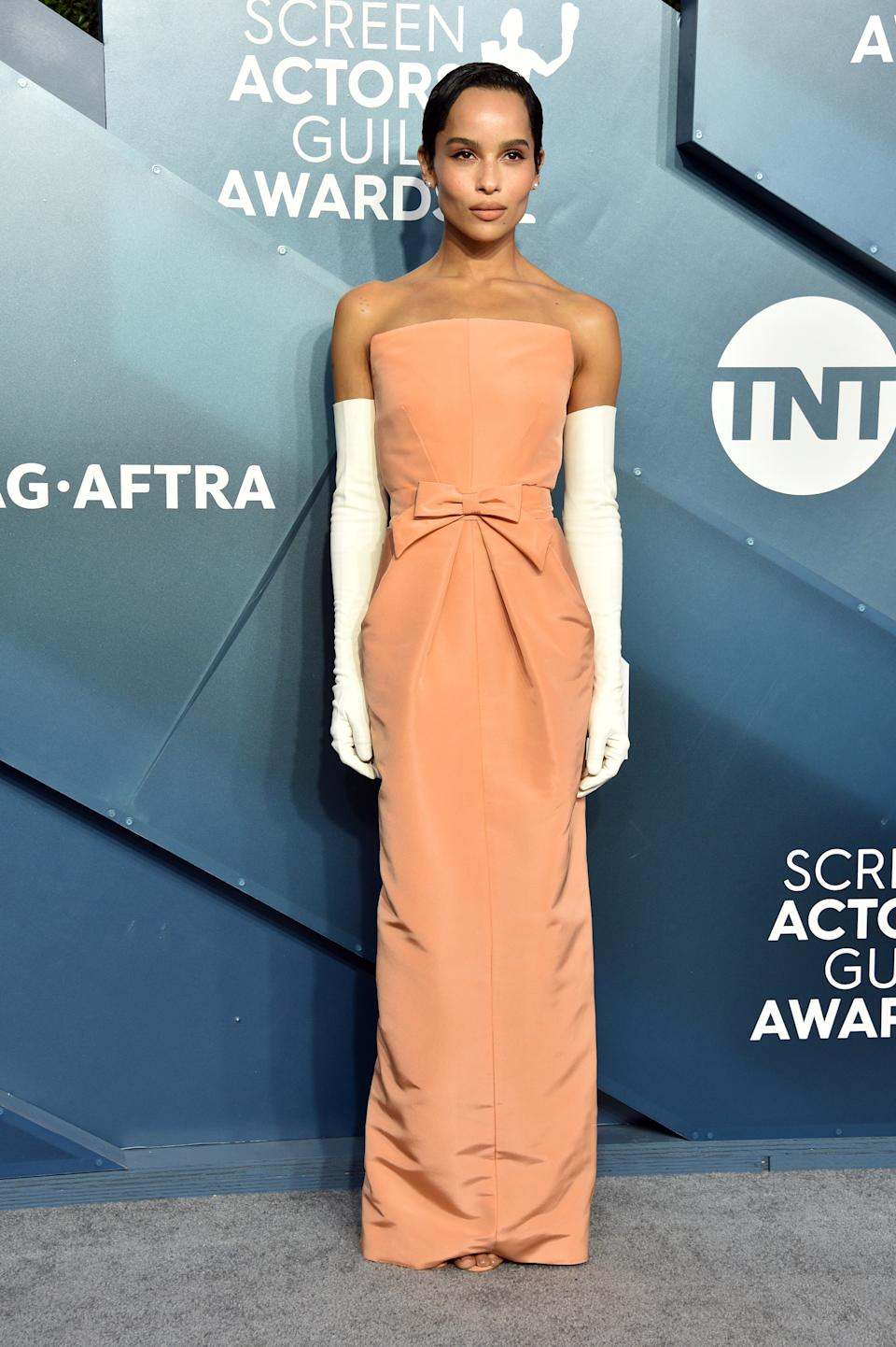 """<h2>Zoë Kravitz in Oscar de la Renta</h2><br>Zoë Kravitz just made all of our dreams come true in this Creamsicle-colored strapless gown paired with white evening clothes.<span class=""""copyright"""">Photo by Gregg DeGuire/Getty Images for Turner.</span>"""