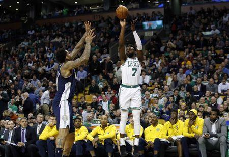 Dec 13, 2017; Boston, MA, USA; Boston Celtics guard Jaylen Brown (7) shoots over Denver Nuggets forward Wilson Chandler (21) during the second half of Boston's 124-118 win at TD Garden. Winslow Townson-USA TODAY Sports