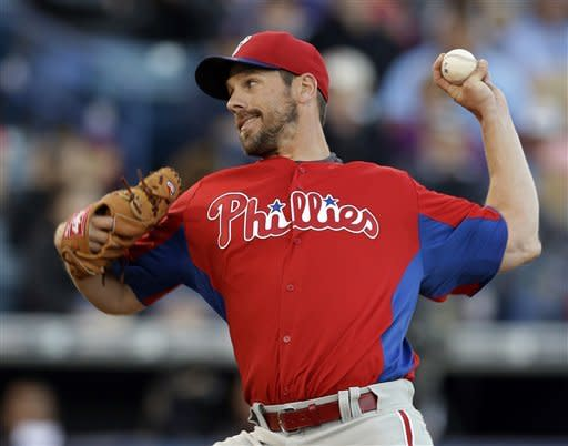 Philadelphia Phillies starting pitcher Cliff Lee (33) delivers against the New York Yankees in the first inning in a spring training exhibition baseball game in Tampa, Fla., Wednesday, March 13, 2013. (AP Photo/Kathy Willens)