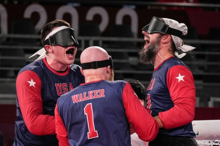 USA's Calahan Young (left), John Kusku (right) and Daryl Walker (centre) celebrate after inflicting a first defeat in five years on Brazil 8-6 in their goalball Group A clash on Thursday