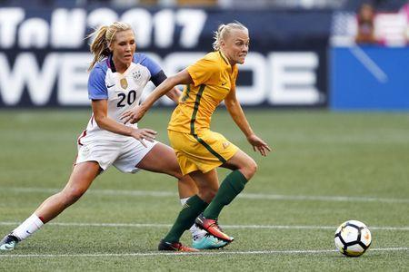 Jul 27, 2017; Seattle, WA, USA; Australia midfielder Tameka Butt (13) passes away from USA midfielder Allie Long (20) during the first half at Century Link Field. Mandatory Credit: Joe Nicholson-USA TODAY Sports