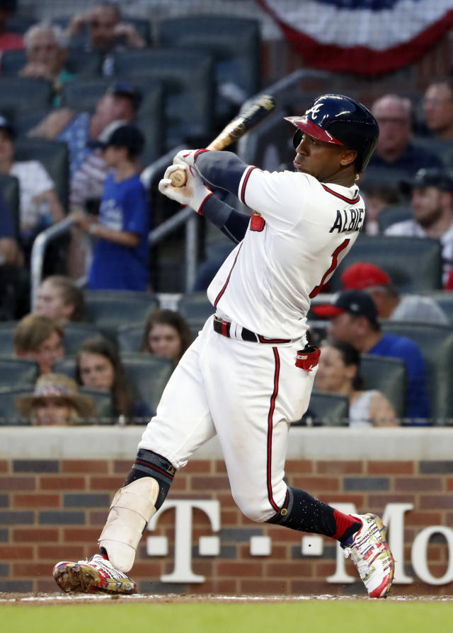 Atlanta Braves' Ozzie Albies follows through on a three-run home run during the third inning of the team's baseball game against the Philadelphia Phillies on Thursday, July 4, 2019, in Atlanta. (AP Photo/John Bazemore)
