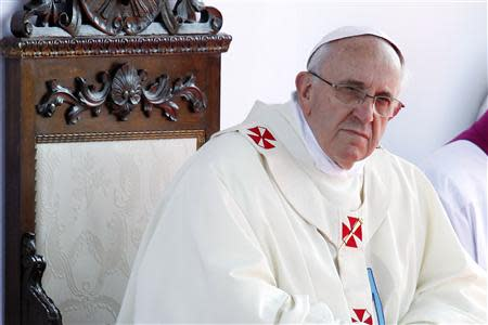 Pope Francis looks on as he leads a mass outside the Shrine of Our Lady of Bonaria in Cagliari