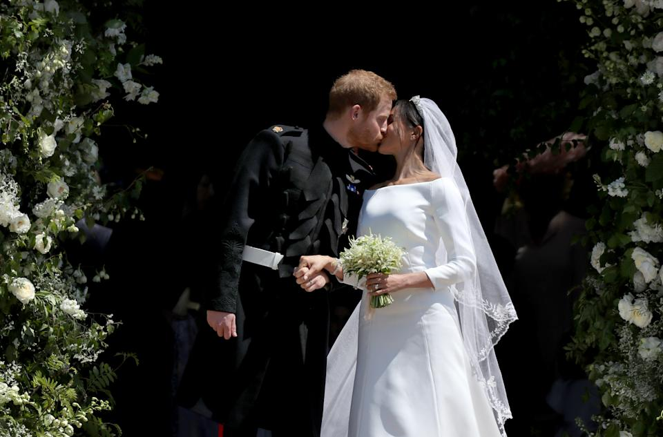 Prince Harry and Meghan Markle kiss outside St George's Chapel in Windsor Castle after their wedding