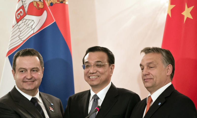 China's Premier Li Keqiang, center, shakes hands with Serbia's Premier Ivica Dacic, left, and Hungary's Premier Viktor Orban, right, in Bucharest, Romania, Monday, Nov. 25, 2013. The three heads of government said they agreed on a project for the modernization of the railways infrastructure in Serbia and Hungary, with assistance from China. (AP Photo/Vadim Ghirda)