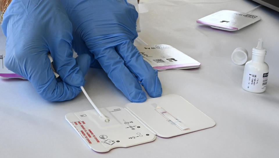 PALOS VERDES ESTATES, CA - AUGUST 24: A rapid COVID-19 test swab is processed at Palos Verdes High School in Palos Verdes Estates on Tuesday, August 24, 2021. The district is encouraging all students and staff to test before the first day of school, August 25, and there are three sites for the drive-up testing. (Photo by Brittany Murray/MediaNews Group/Long Beach Press-Telegram via Getty Images)