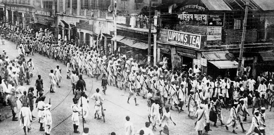 (Original Caption) Uprisings in Calcutta Worry England. The uprisings among the natives in Calcutta has caused much concern in England. The great plan devised by Gandhi, the native leader, for a general upheaval against the British authority in India has gathered great force and his arrest followed. Here is a view of the native procession after the arrest of Gandhi.