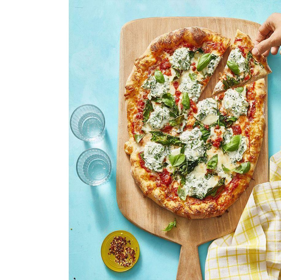 """<p>This hearty meal combines two delicious dishes: pizza and pasta. How can you say no? </p><p><em><a href=""""https://www.womansday.com/food-recipes/food-drinks/a31001915/lasagna-style-pizza-recipe/"""" rel=""""nofollow noopener"""" target=""""_blank"""" data-ylk=""""slk:Get the Lasagna-Style Pizza recipe."""" class=""""link rapid-noclick-resp"""">Get the Lasagna-Style Pizza recipe. </a></em></p>"""
