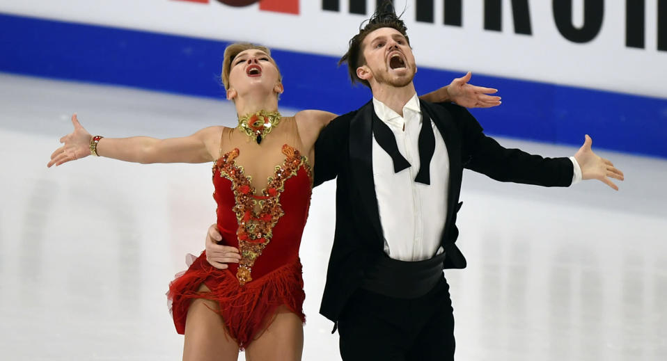 Russian ice dancers Alexandra Stepanova and Ivan Bukin perform during the Ice Dance - Rhythm Dance at the Figure Skating World Championships in Stockholm, Sweden, Friday, March 26, 2021. (AP Photo/Martin Meissner)