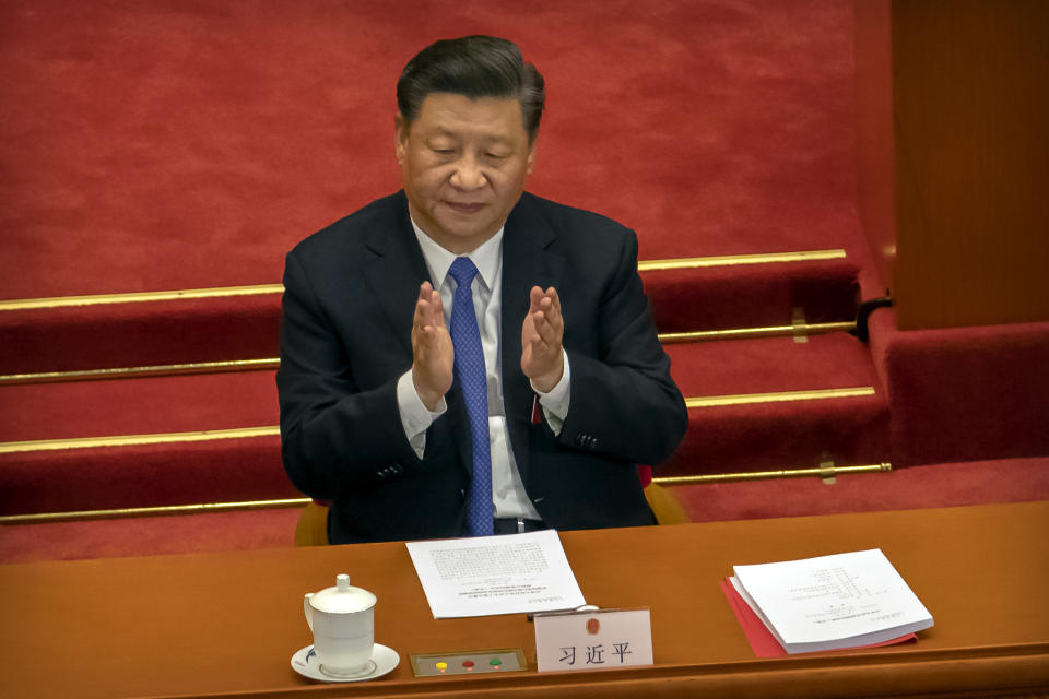 Chinese President Xi Jinping applauds during the closing session of China's National People's Congress (NPC) in Beijing, Thursday, May 28, 2020. China's ceremonial legislature overwhelmingly endorsed a national security law for Hong Kong on Thursday that has strained relations with the United States and Britain and triggered protests in the semi-autonomous territory. (AP Photo/Mark Schiefelbein)