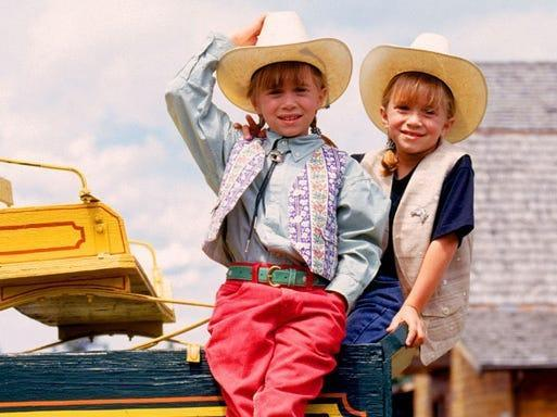 """young Mary-Kate and Ashley Olsen in cowgirl hates in """"How the West Was Fun."""""""
