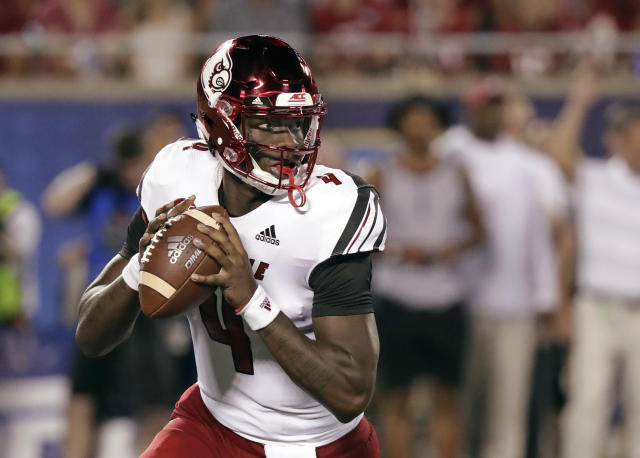 Louisville quarterback Jawon Pass looks for a receiver during the first half of the team's NCAA college football game against Alabama, Saturday, Sept. 1, 2018, in Orlando, Fla. (AP Photo/John Raoux)