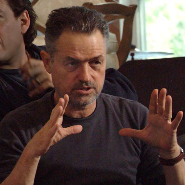 "This undated photo provided by Material Culture, Jonathan Demme is photographed on a movie set. Now 70 and having spent the better part of three decades amassing pieces from Haiti and other Caribbean countries as well as the United States, South America and Africa, the director of ""The Silence of the Lambs"" said he's looking to ""streamline and simplify"" his life by selling 90 percent of his well-regarded collection of self-taught or ""outsider"" art. More than 900 pieces, many of them by artists with little or no formal training but abundant talent — will be auctioned at Philadelphia's Material Culture on March 29-30. The sale will be preceded by a weeklong exhibition that is free and open to the public. (AP Photo/Material Culture)"
