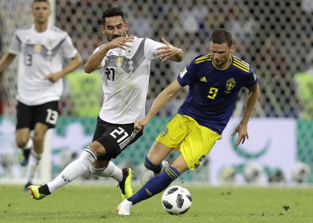 Germany's Ilkay Gundogan, left, and Sweden's Marcus Berg challenge for the ball during the group F match between Germany and Sweden at the 2018 soccer World Cup in the Fisht Stadium in Sochi, Russia, Saturday, June 23, 2018. (AP Photo/Michael Probst)