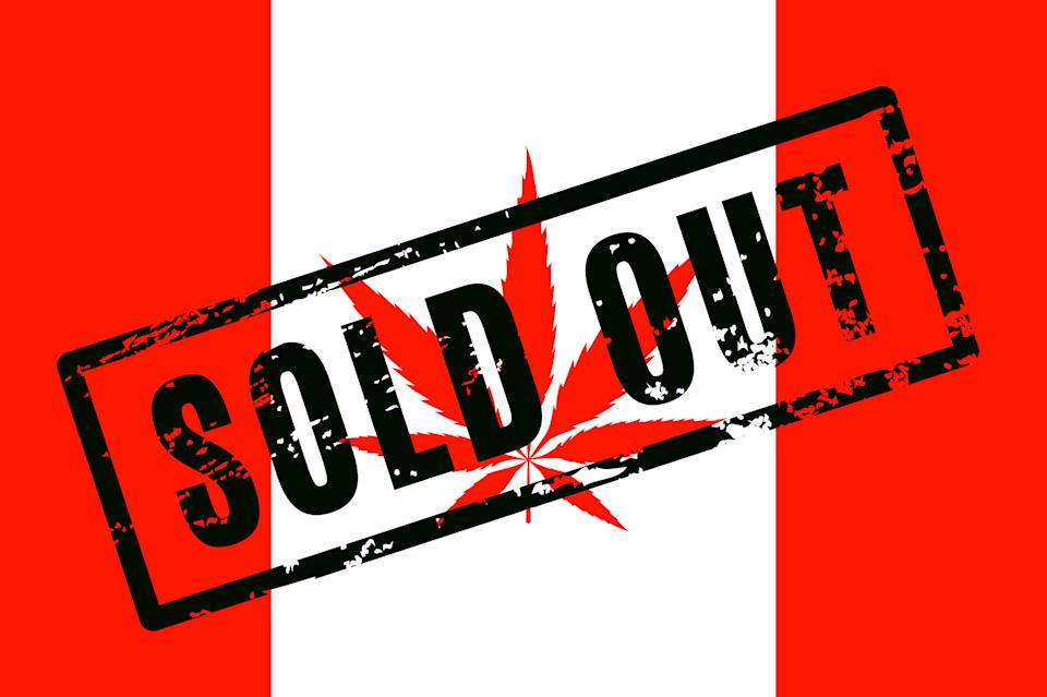 A Canadian flag with a red cannabis leaf in place of the maple leaf, and the words Sold Out stamped across the flag.