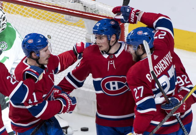 Montreal Canadiens left wing Artturi Lehkonen (62) is congratulated by teammates right wing Brendan Gallagher (11) and left wing Alex Galchenyuk (27) following a goal as they face the Dallas Stars during the second period of an NHL hockey game in Montreal on Tuesday, March 13, 2018. (Paul Chiasson/The Canadian Press via AP)