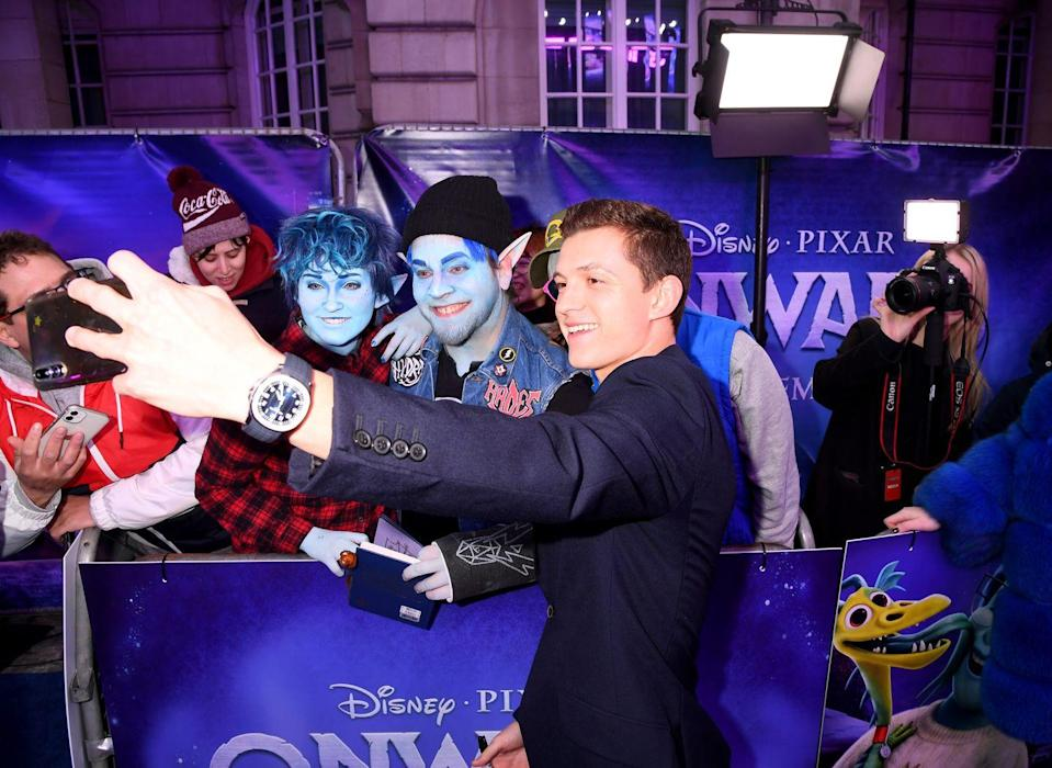 <p>Tom Holland poses with fans at the <em>Onward</em> UK Premiere at The Curzon Mayfair on February 23, 2020 in London, England.</p>