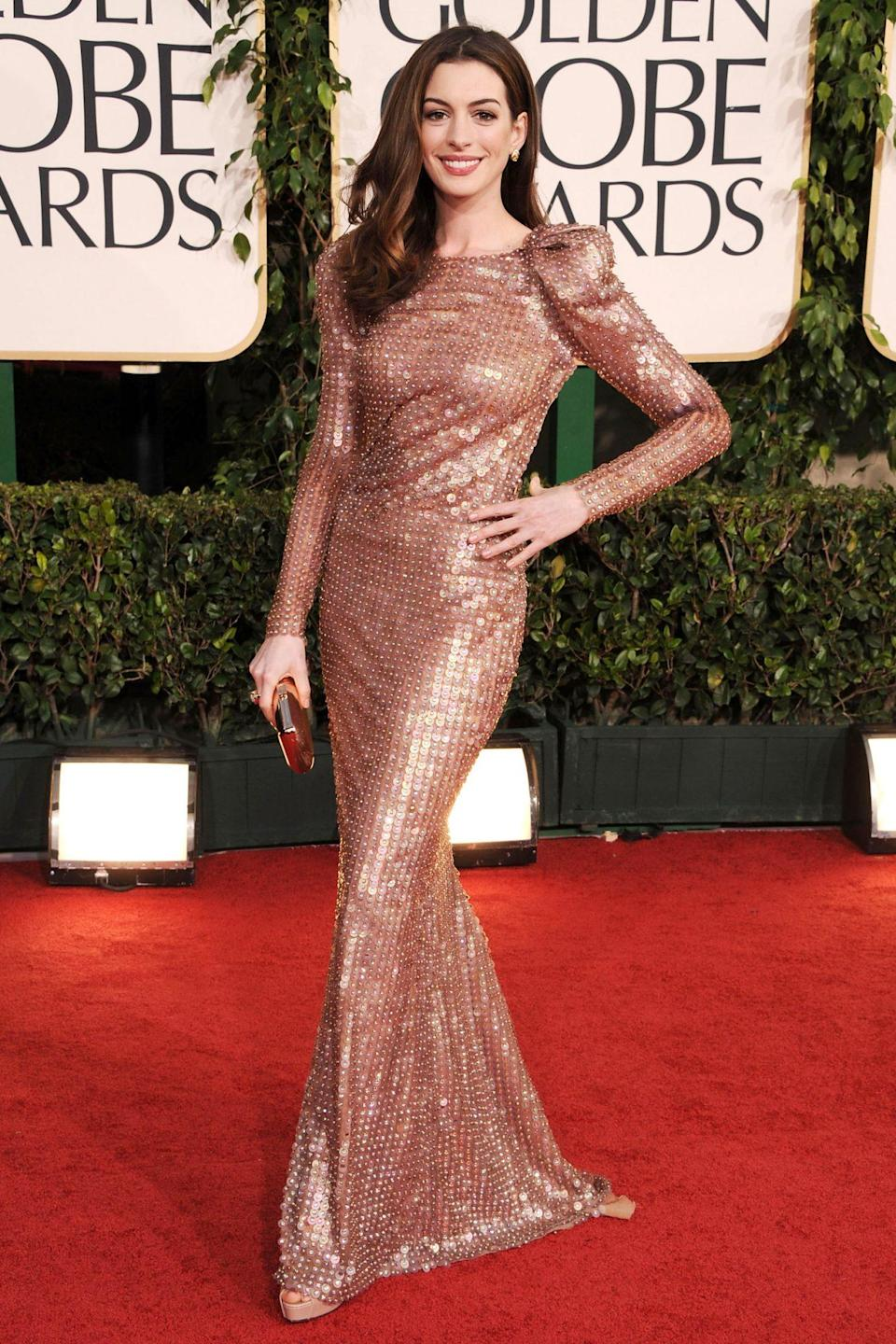 <p>Anne Hathaway went for a strong shoulder and lots of sparkle in her rose gold Armani Privé gown.</p>