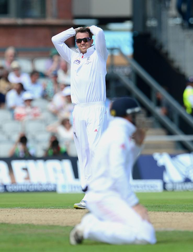 England's Graeme Swann shows his dejection after a dropped catch, during day one of the Third Investec Ashes test match at Old Trafford Cricket Ground, Manchester.