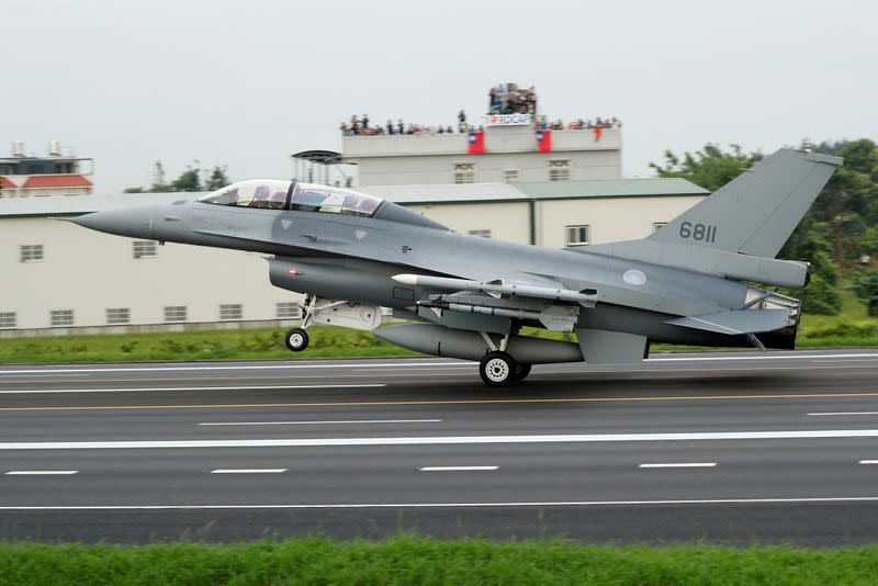 FILE PHOTO: A ROCAF F-16V fighter jet lands on a highway used as an emergency runway during the Han Kuang military exercise simulating the China's People's Liberation Army (PLA) invading the island, in Changhua