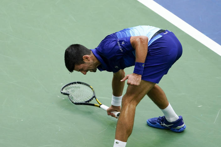 Novak Djokovic, of Serbia, smashes his racket on the court after losing a point to Daniil Medvedev, of Russia, during the men's singles final of the US Open tennis championships, Sunday, Sept. 12, 2021, in New York. (AP Photo/Seth Wenig)