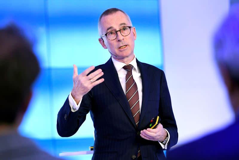 FILE PHOTO: ASML CFO Roger Dassen attends a news conference after fourth quarter earnings in Veldhoven