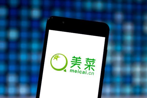 The logo of Chinese e-commerce start-up Meicai, which delivers fresh produce straight from the farms to restaurants and stores, is displayed on a smartphone. Photo: Shutterstock
