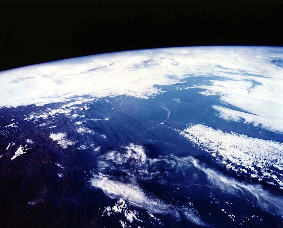 The planet is thought to be able to support water and an atmosphere, like our Earth (pictured) (Image: Rex)