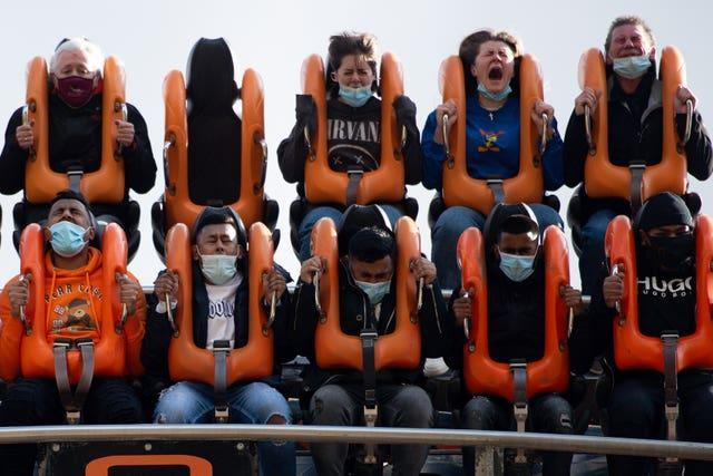People enjoy the attractions at Alton Towers in Staffordshire (Jacob King/PA)
