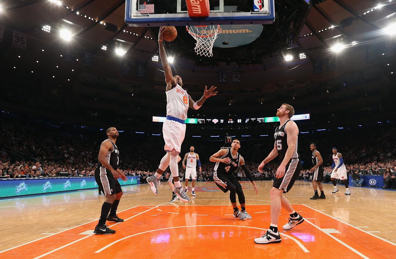 NEW YORK, NY - JANUARY 03: J.R. Smith #8 of the New York Knicks scores a second half basket against the San Antonio Spurs at Madison Square Garden on January 3, 2013 in New York City. NOTE TO USER: User expressly acknowledges and agrees that, by downloading and/or using this photograph, user is consenting to the terms and conditions of the Getty Images License Agreement. The Knicks defeated the Spurs 100-83. (Photo by Bruce Bennett/Getty Images)