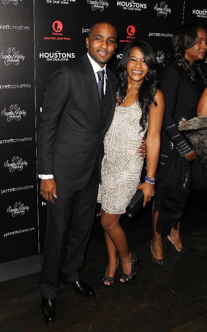 "File- This Oct. 12, 2012 file photo shows Nick Gordon and Bobbi Kristina Brown attending the premiere party for ""The Houstons On Our Own"" at the Tribeca Grand hotel in New York. A rep for the family confirmed Friday Jan. 10, 2014, that the 20-year-old Brown married Gordon. But the rep did not know where or when the marriage took place. ( Photo by Donald Traill/Invision/AP,File)"