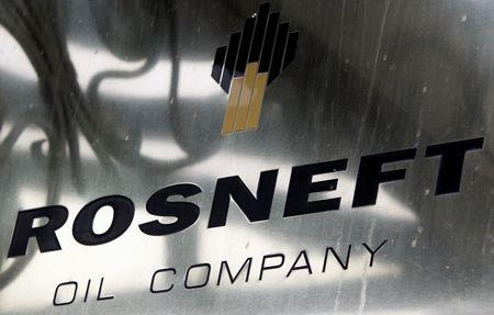 FILE PHOTO: A logo of Russian state oil firm Rosneft is seen at its office in Moscow, October 18, 2012. REUTERS/Maxim Shemetov/File Photo