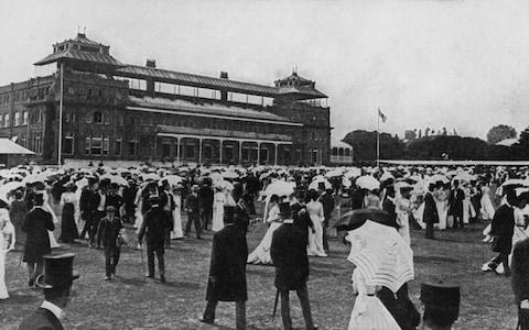 Spectators take the field at Lord's during the lunch break at the Eton versus Harrow cricket match in 1905 - six years after Trott's mighty drive - Credit: Hulton Archive/Getty Images